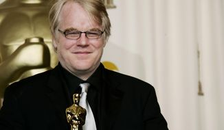 "FILE - In a Sunday, March 5, 2006, file photo, actor Philip Seymour Hoffman poses with the Oscar he won for best actor for his work in ""Capote"" at the 78th Academy Awards, in Los Angeles.   Police say  Hoffman has been found dead in his  apartment. Sunday Feb. 2014.  HE WAS 46.(AP Photo/Kevork Djansezian, File)"