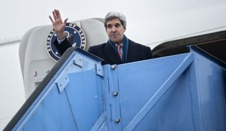 U.S. Secretary of State John Kerry waves while boarding his plane at Franz-Josef-Strauss Airport in Munich, southern Germany, on Sunday Feb. 2, 2014. Kerry was in the Bavarian capital to attend the Munich Security Conference. (AP Photo/Brendan Smialowski,Pool)I