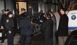 """A body is taken from the apartment building that Philip Seymour Hoffman lived in, Sunday, Feb. 2, 2014, in New York. Hoffman, who won an Oscar for best actor in 2006 for his portrayal of writer Truman Capote in """"Capote"""", was found dead Sunday in his apartment. He was 46. (AP Photo/Louis Lanzano)"""