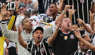 FILE - In this May 19, 2013 file photo, Corinthian's supporters cheer during the final match of the Sao Paulo State soccer league against Santos, in Santos, Brazil. The popular Brazilian club Corinthians is expected to release security-camera images of the Feb. 1, 2014, attack by fans to some of its players, which happened at a training center that will be used during the World Cup. (AP Photo/Andre Penner, File)