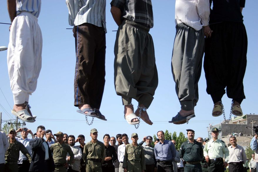 Extreme punishment: Public hangings of convicted criminals in Iran have risen to more than 66 per month since Hassan Rouhani, portrayed as a moderate reformer, became president in August. Rights advocates say international law is being violated. (Associated Press)