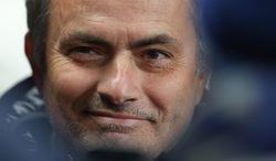 Chelsea's manager Jose Mourinho smiles as he waits for the English Premier League soccer match between Manchester City and Chelsea at the Etihad Stadium, Manchester, England, Monday, Feb. 3, 2014. (AP Photo/Jon Super)