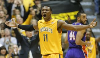Wichita State's Cleanthony Early celebrates after hitting a 3-point basket against Evansville during a first-half rally of an NCAA college basketball game in Wichita, Kan., Saturday, Feb. 1, 2014. (AP Photo/The Wichita Eagle, Travis Heying) LOCAL TV OUT; MAGAZINES OUT; LOCAL RADIO OUT; LOCAL INTERNET OUT