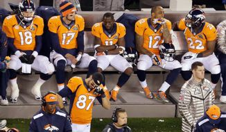 Denver Broncos' Peyton Manning sits with teammates late in the second half of the NFL Super Bowl XLVIII football game against the Seattle Seahawks, Sunday, Feb. 2, 2014, in East Rutherford, N.J. The Seattle Seahawks won 43-8. (AP Photo/Mel Evans)