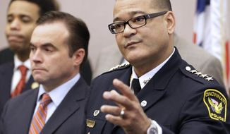 Cincinnati Police Chief Jeffrey Blackwell speaks at a news conference with Mayor John Cranley, left, Monday, Feb. 3, 2014, at City Hall in Cincinnati. Cranley and Blackwell introduced a new initiative to address the recent rash of homicides and violent crimes in the city. (AP Photo/Al Behrman)