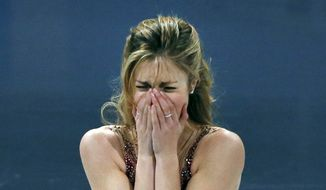 U.S. Olympic skater Ashley Wagner becomes emotional after her performance at the skating spectacular after the U.S. Figure Skating Championships in Boston, Sunday, Jan. 12, 2014. (AP Photo/Elise Amendola)