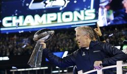 Seattle Seahawks head coach Pete Carroll holds the the Vince Lombardi Trophy after the NFL Super Bowl XLVIII football game against the Denver Broncos Sunday, Feb. 2, 2014, in East Rutherford, N.J. The Seahawks won 43-8. (AP Photo/Julio Cortez)