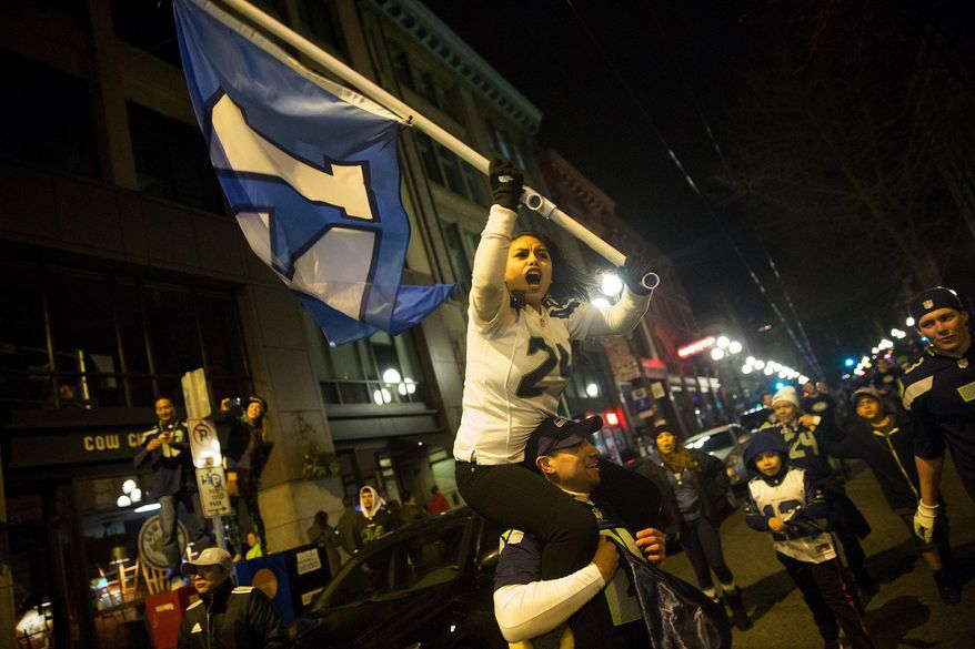 Thousands of Seattle Seahawk fans celebrate in the Pioneer Square neighborhood in Seattle after  the Seahawks Super Bowl win Sunday, Feb. 2, 2014, over the Denver Broncos. (AP Photo/The Seattle Times, Erika Schultz)