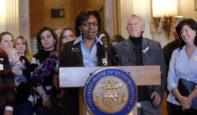 Rep. Rhonda Fields, D-Aurora, speaks at a news conference at the Capitol in Denver on Monday, Feb. 3, 2014, where she urged lawmakers to not recall her bill from last session that required background checks on private gun sales. (AP Photo/Ed Andrieski)