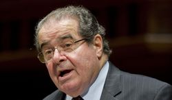 In this March 8, 2012, file photo, Supreme Court Justice Antonin Scalia speaks at Wesleyan University in Middletown, Conn. (AP Photo/Jessica Hill, File)** FILE **