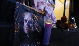 A makeshift memorial sits outside the home of actor Philip Seymour Hoffman, Monday, Feb. 3, 2014, in New York. Hoffman, 46, was found dead Sunday in his apartment of a suspected drug overdose. (AP Photo/Jason DeCrow)