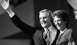 "FILE - In this July 19, 1984 file photo, then Democratic presidential nominee Walter Mondale and his wife Joan smile broadly as they thank the delegates from the podium following Mondale's nomination in San Francisco. Joan Mondale, who burnished a reputation as ""Joan of Art"" for her passionate advocacy for the arts while her husband was vice president and a U.S. ambassador, died Monday, Feb. 3, 2014. She was 83.  (AP Photo, File)"