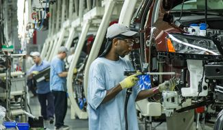 ** FILE ** In this June 12, 2013, file photo, workers assemble Volkswagen Passat sedans at the German automaker's plant in Chattanooga, Tenn. Workers at Volkswagen's only U.S. factory will decide in February 2014 whether to be represented by the United Auto Workers union. (AP Photo/ Erik Schelzig, file)