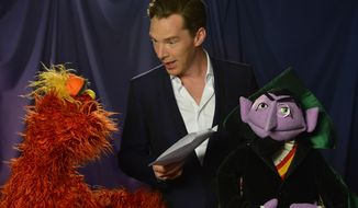 "This image released by PBS shows ""Sesame Street"" characters Murray Monster, left, and Count von Count, right, with actor Benedict Cumberbatch during the taping of a video for posted Tuesday, Feb. 4, 2014, on PBS' YouTube channel. With the help of Count and Murray, Cumberbatch explains how to count up four apples and three oranges, and which is the greater number. (AP Photo/PBS)"