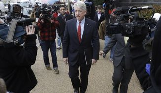 Virginia Attorney General Mark Herring leaves Federal Court after a hearing on Virginia's ban on gay marriage in Norfolk, Va., Tuesday, Feb. 4, 2014.  Herring the state's newly elected Democratic attorney general has already decided to side with the plaintiffs and will not defend the ban.  (AP Photo/Steve Helber)