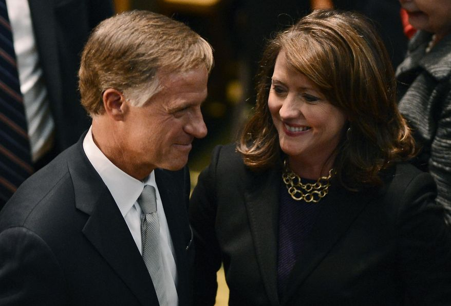 Tennessee Gov. Bill Haslam leaves with his wife Chrissy Haslam after delivering his State of the State address to a joint session of the General Assembly, Monday, Feb. 3, 2014, in Nashville, Tenn. (AP Photo/Mark Zaleski)