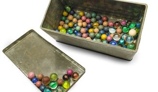 This Nov. 14, 2013 photo provided by the Anne Frank House Amsterdam on Tuesday, Feb. 4, 2014, shows a set of marbles belonging to Anne Frank. Shortly before Anne Frank and her family went into hiding from the Nazis, she gave away some of her toys to non-Jewish neighborhood girlfriend Toosje Kupers for safekeeping. The toys have now been recovered and Anne's tin of marbles will go on display for the first time this week at an art gallery in Rotterdam, the Anne Frank House Museum says. (AP Photo/Anne Frank House Amsterdam, Diederik Schiebergen))
