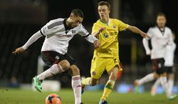 Fulham's Clint Dempsey, left, shields the ball from Sheffield United's Stefan Scougall during their 4th round replay English FA Cup soccer match between Fulham and Sheffield United at Craven Cottage stadium in London, Tuesday, Feb. 4, 2014. (AP Photo/Alastair Grant)
