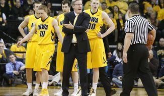 Iowa coach Fran McCaffery talks with an official during a timeout in the second half of an NCAA college basketball game against Ohio State at Carver-Hawkeye Arena in Iowa City, Iowa, on Tuesday, Feb. 4, 2014. Ohio State won 76-69. (AP Photo/Cliff Jette)