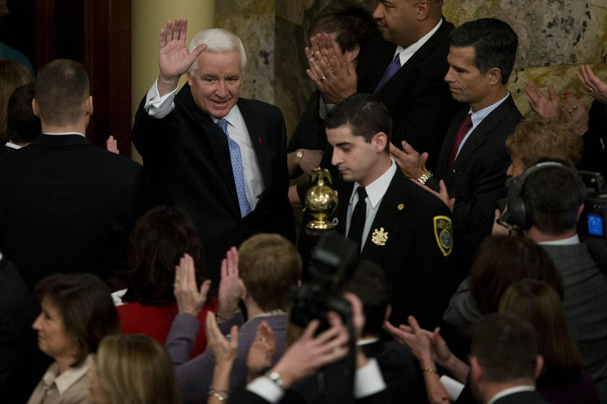 Gov. Tom Corbett, left,  arrives to deliver his budget address for the 2014-15 fiscal year to a joint session of the Pennsylvania House and Senate on Tuesday, Feb. 4, 2014, in Harrisburg, Pa. (AP Photo/Matt Rourke)