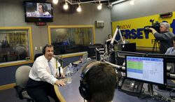 """New Jersey Gov. Chris Christie, left, sits in a studio during his radio program, """"Ask the Governor"""" broadcast on NJ 101.5, Monday, Feb. 3, 2014, in Ewing, N.J. During the program, Christie took questions from callers for the first time in more than three weeks as his campaign looked for a way to pay for lawyers as a political payback scandal continues. (AP Photo/Mel Evans, Pool)"""