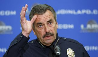 Los Angeles Police Chief Charlie Beck speaks at news conference at LAPD headquarters in downtown Los Angeles Tuesday, Feb. 4, 2014.  A civilian oversight board has determined that eight Los Angeles police officers violated department policy when they mistakenly opened fire on two women during the manhunt for rogue ex-cop Christopher Dorner.  The Police Commission's decision announced Tuesday leaves the question of disciplinary measures to Beck.  The officers have been assigned to non-field duties pending the internal investigation.  (AP Photo/Reed Saxon)