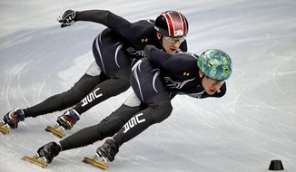 United States short track speed skating teammates J.r. Celski, right, and Christopher Creveling run through a training session at the Iceberg Skating Palace at the 2014 Winter Olympics, Sunday, Feb. 2, 2014, in Sochi, Russia. (AP Photo/David Goldman)