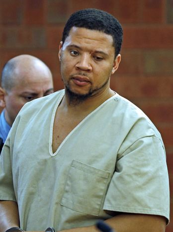 Alexander Bradley, an associate of former New England Patriots football player Aaron Hernandez, stands during arraignment on weapons charges Tuesday, Feb. 4, 2014, in Superior Court in Hartford, Conn. Bradley was shot in the leg outside a Hartford nightclub Sunday night, where police said he returned gunfire. Bradley alleges he was shot in the face by Hernandez in Florida last year. (AP Photo/Boston Herald, Nancy Lane , Pool)