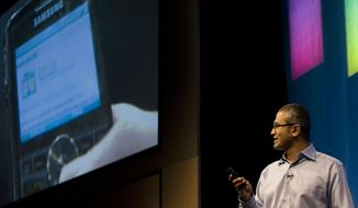 This May 21, 2008 photo, Microsoft Senior Vice President of Portal and Advertising Platform Group Satya Nadella demonstrates some of the features of Live Search on a mobile device during the advance08 Advertising Leadership Forum at the company's campus in Redmond, Wash.  Microsoft announced Tuesday, Feb. 4, 2014,  that Nadella will replace Steve Ballmer as its new CEO.  Nadella will become only the third leader in the software giant's 38-year history, after founder Bill Gates and Ballmer. Board member John Thompson will serve as Microsoft's new chairman. (AP Photo/Stephen Brashear)