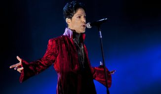 """FILE - In this Aug. 9, 2011 file photo, U.S. musician Prince performs during his concert at the Sziget Festival on the Shipyard Island, northern Budapest, Hungary. The enigmatic star flew into London on Tuesday, Feb. 4, 2014, at the start of a still-evolving string of dates in support of forthcoming album """"Plectrum Electrum,"""" recorded with all-female trio 3RDEYEGIRL. (AP Photo/MTI, Balazs Mohai, File) HUNGARY OUT"""