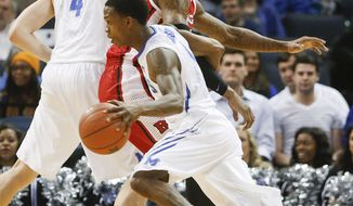 Memphis guard Joe Jackson (1) uses a pick by teammate Austin Nichols (4) to get around Rutgers forward J.J. Moore, back, in the first half of an NCAA college basketball game, Tuesday, Feb. 4, 2014, in Memphis, Tenn. (AP Photo/Lance Murphey)