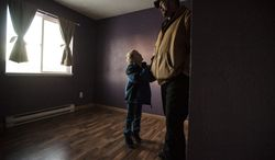 In this Jan. 28, 2014 photo, Camden Kler, 6, asks his father Spencer if he can keep the purple paint on the walls of his new bedroom after the family's offer to buy the home was accepted, in Casper, Wyo. Wyoming ranks fourth in the nation in overall financial security of residents, according to a recent report, in part because the state's housing foreclosure rate is lowest among all U.S. states. (AP Photo/Casper Star-Tribune, Ryan Dorgan)