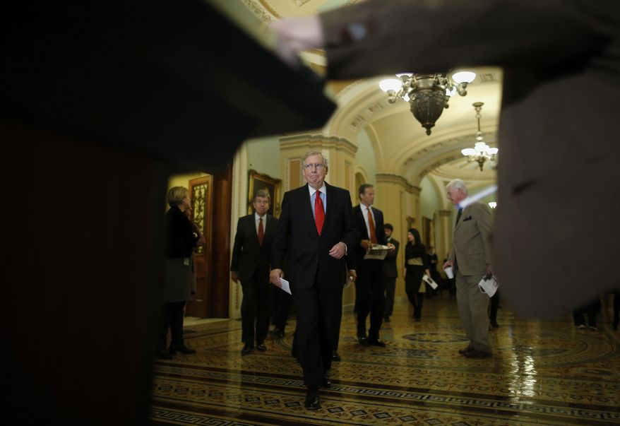 Senate Minority Leader Mitch McConnell of Ky., followed by Sen. Roy Blunt, R-Mo., left, and Sen. John Thune, R-S.D., arrives for a news conference on Capitol Hill in Washington, Tuesday, Feb. 4, 2014, after their weekly policy luncheon. (AP Photo/Charles Dharapak)