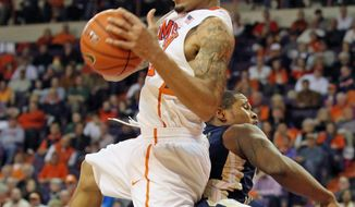 Clemson's K.J. McDaniels grabs a rebound during the first half of an NCAA college basketball game against Georgia Tech in Clemson, S.C., Tuesday, Feb. 4, 2014. (AP Photo/The Independent-Mail, Mark Crammer)