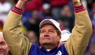 New York Giants head coach Jim Fassel holds up theNFC  Championship trophy after defeating the Minnesota Vikings 41-0 Sunday, Jan. 14, 2001, in East Rutherford, N.J. (AP Photo/Bill Kostroun)