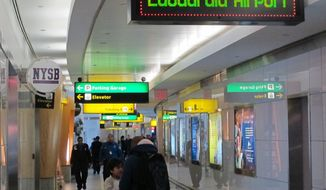 **FILE** In this Jan. 10, 2014 photo, passengers maneuver through one of the cramped hallways at New York's LaGuardia Airport.  (AP Photo/Frank Eltman)