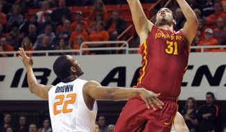 Iowa State's Georges Niang (31) takes a shot over Oklahoma State's Markel Brown (22) during the first half of an NCAA college basketball game in Stillwater, Okla., Monday, Feb. 3, 2014. (AP Photo/Brody Schmidt)