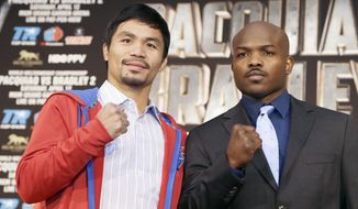 Manny Pacquiao, left of the Philippines, and Tim Bradley pose at a news conference to promote their upcoming WBO welterweight championship boxing rematch in Beverly Hills, Calif., Tuesday, Feb. 4, 2014.  Pacquiao and Bradley's first match on June 9, 2012 was a split decision in favor of Bradley, which ended Pacquiao's welterweight title reign as well as his seven-year, 15-bout winning streak.  Pacquiao vs. Bradley 2 will take place Saturday, April 12, 2014, in Las Vegas. (AP Photo/Reed Saxon)