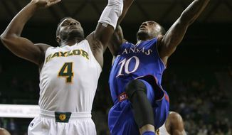 Baylor guard Gary Franklin (4) defends against a shot by Kansas' Naadir Tharpe (10) in the first half of an NCAA college basketball game, Tuesday, Feb. 4, 2014, in Waco, Texas. (AP Photo/Tony Gutierrez)