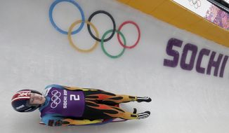 Erin Hamlin of the United States completes a training run for the women's luge singles at the 2014 Winter Olympics, Tuesday, Feb. 4, 2014, in Krasnaya Polyana, Russia. (AP Photo/Michael Sohn)