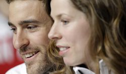 Denny Morrison, left, a member of the Canadian speed skating team, sits with teammate Christine Nesbitt after a 2014 Winter Olympics team news conference, Tuesday, Feb. 4, 2014, in Sochi, Russia. (AP Photo/Patrick Semansky)