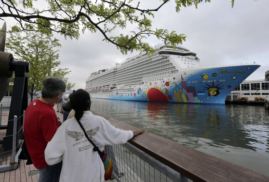 FILE - In this May 8, 2013, file photo, people pause to look at Norwegian Cruise Line's new ship, Norwegian Breakaway, on the Hudson River, in New York. A 4-year-old child died after being pulled unresponsive from a swimming pool on the Norwegian Breakaway, off the coast of North Carolina on Monday, Feb. 3, 2014, cruise line and Coast Guard officials said. Crew members were able to revive a 6-year-old boy also found in the pool. He was airlifted to a hospital, where his condition was unknown. (AP Photo/Richard Drew, File)