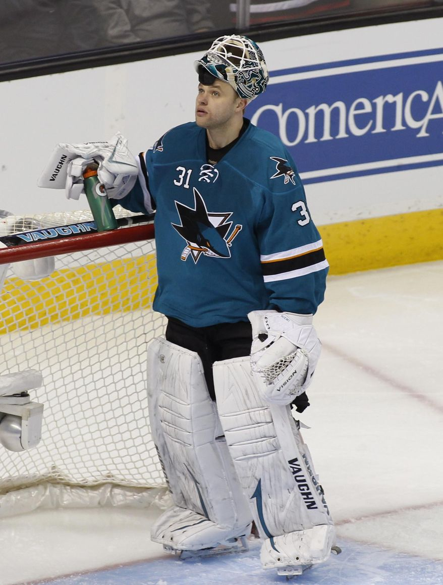 San Jose Sharks goalie Antti Niemi, looks up after giving up a goal to the Philadelphia Flyers during the third period of an NHL hockey game, Monday, Feb. 3, 2014, in San Jose, Calif. (AP Photo/George Nikitin)