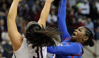 SMU's Gabrielle Wilkins (3) drives past Connecticut's Stefanie Dolson (31) during the first half of an NCAA college basketball game in Storrs, Conn., Tuesday, Feb. 4, 2014. (AP Photo/Fred Beckham)