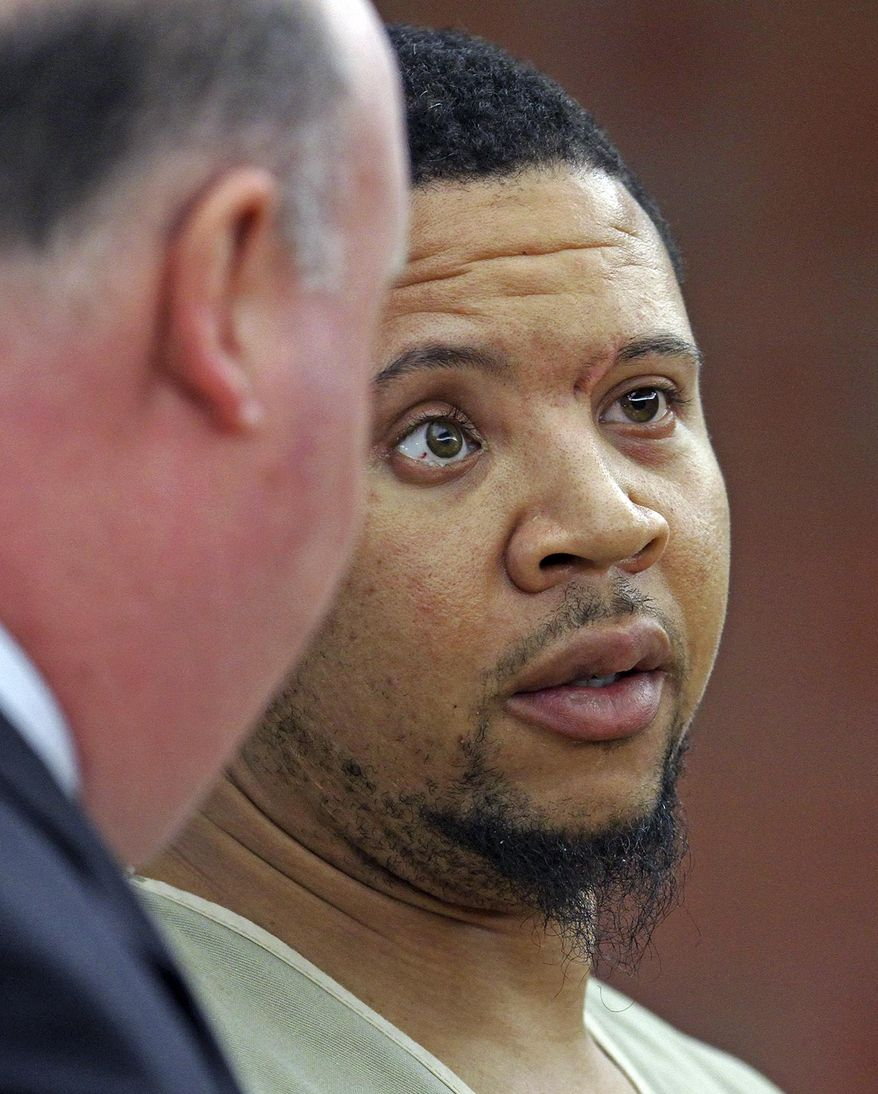 Alexander Bradley, an associate of former New England Patriots football player Aaron Hernandez, listens to his attorney Robert Pickering, left, during arraignment on weapons charges Tuesday, Feb. 4, 2014, in Superior Court in Hartford, Conn. Bradley was shot in the leg outside a Hartford nightclub Sunday night, where police said he returned gunfire. Bradley alleges he was shot in the face by Hernandez in Florida last year. (AP Photo/Boston Herald, Nancy Lane , Pool)