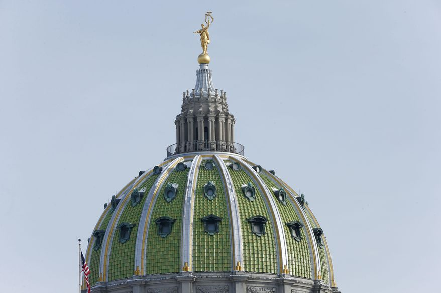 The Pennsylvania state capitol building is seen ahead of Gov. Tom Corbett's scheduled budget proposal address for the fiscal year 2014-2015 to a joint session of the Pennsylvania House and Senate on Tuesday, Feb. 4, 2014, in Harrisburg, Pa. (AP Photo/Matt Rourke)