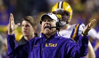 FILE - In this Nov. 23, 2013, file photo, LSU head coach Les Miles reacts to a touchdown call for Texas A&M that was later overturned on replay during the second half of an NCAA college football game in Baton Rouge, La. Recruiting is the lifeline of college coaches and with teenagers using social media like Twitter to communicate, some football staffs have pushed the boundaries of NCAA regulations to reach top high school recruits. Miles was reminded by LSU administration officials to use caution when taking to Twitter to discuss recruiting. National Signing Day is Wednesday, Feb. 5. (AP Photo/Gerald Herbert, File)