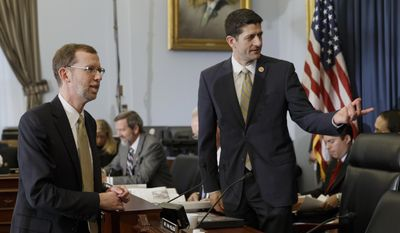 House Budget Committee Chairman Rep. Paul Ryan, R-Wis., right, greets Congressional Budget Office (CBO) Director Douglas Elmendorf on Capitol Hill in Washington, Wednesday, Feb. 5, 2014, prior to Elmendorf testifying before the committee's hearing on the CBO budget and economic outlook. (AP Photo/J. Scott Applewhite)