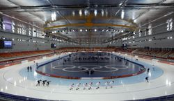 Speedskaters from various countries train at the Adler Arena Skating Center during the 2014 Winter Olympics in Sochi, Russia, Wednesday, Feb. 5, 2014. (AP Photo/Matt Dunham)