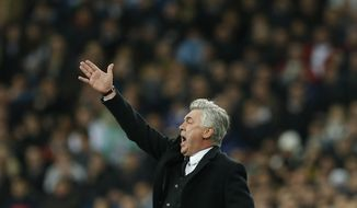 Real's coach Carlo Ancelotti shouts during a semi final, 1st leg, Copa del Rey soccer derby match between Real Madrid and Atletico Madrid at the Santiago Bernabeu Stadium in Madrid, Wednesday Feb. 5, 2014.  (AP Photo/Paul White)